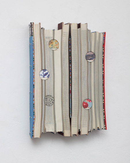 The Flight of the Swan, cut books, textiles, screws, app. 34 x 22 x 6 cm, 2015